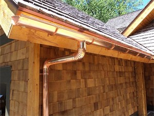 copper gutter on wood home